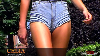 Showing off buttocks & fantastic cameltoe in denim shorts