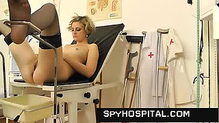 Hidden cam footage of hot gyno exam