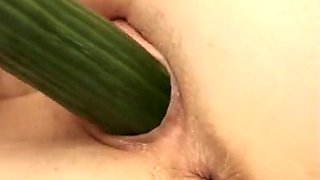Lewd college girl smashes her cunt with a long cucumber