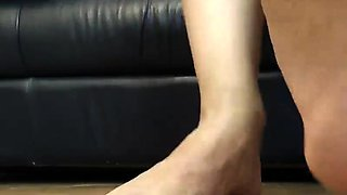 The pedicured toes of this brunette babe will get you horny