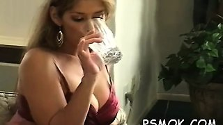 Mature slut blows a boy while smoking a cigarette