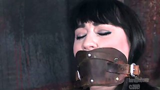 Brunette girl gets her tits beaten and her pussy toyed in BDSM clip