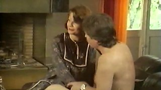 Busty and horny German milf lady on the couch feding on a dick