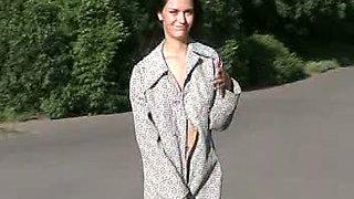 Fabulous brunette Russian teen cutie in coat outside flashes her goodies