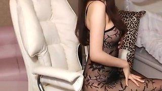 Korean beauty in sexy fishnet bodysuit