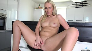 Handsome blondie Jenny Simmons plays with her pussy in the kitchen