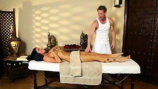 Busty massage babe deepthroating her masseur