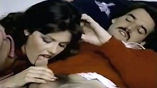 Sizzling hot vintage brunette gives sensual fellatio in the bedroom