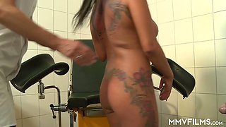 German milf Curly Ann gets her pussy fucked right on the gynecological chair