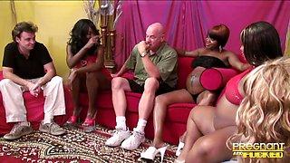 Pregnant black sluts enjoy having interracial group sex party