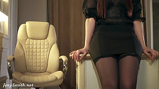Jeny Smith plays the role of the boss. High heels, stockings and mini skirt.