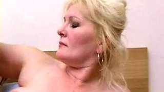 Mature woman and young guy having fun
